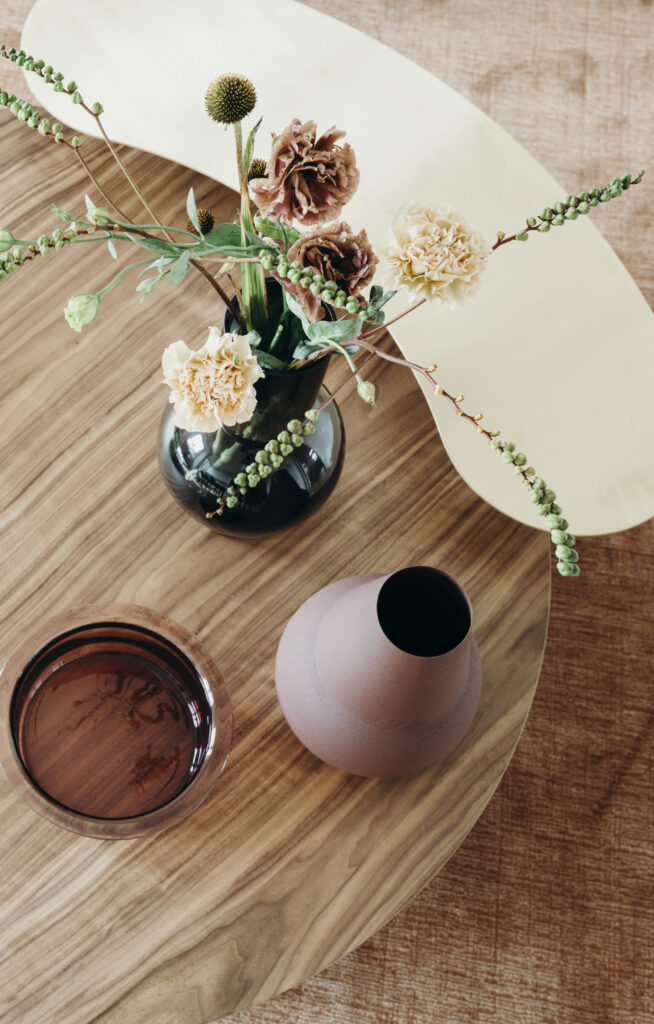 wooden coffee table with feminine details